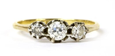Lot 46 - A gold three stone diamond ring