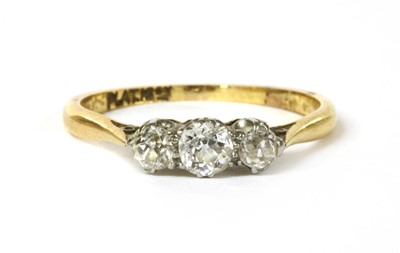 Lot 48 - A gold three stone diamond ring
