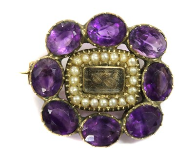 Lot 1 - A Victorian gold amethyst and woven hair brooch