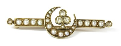 Lot 4 - A late Victorian diamond and split pearl crescent brooch