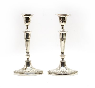 Lot 51 - A pair of Regency-style silver-plated candlesticks