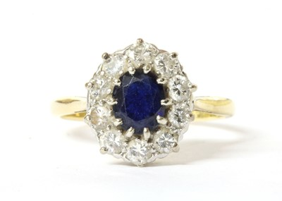 Lot 162 - A gold sapphire and diamond cluster ring