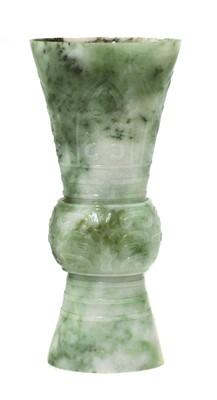 Lot 63 - A Chinese jade gu vase