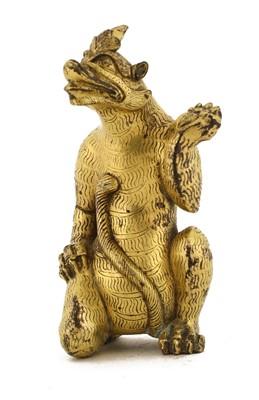 Lot 120 - A Chinese gilt-bronze figure