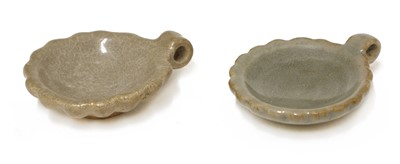 Lot 1 - A pair of Chinese celadon-glazed bird feeders