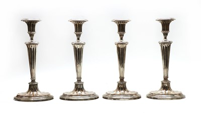 Lot 11 - A set of four George III Sheffield Plated candlesticks of Adam design
