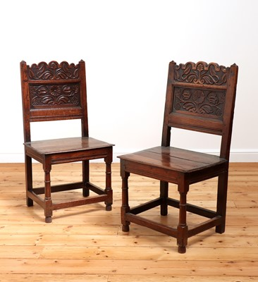 Lot 412 - A pair of Charles II oak backstools