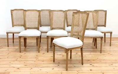 Lot 423 - A set of eight modern bleached oak dining chairs