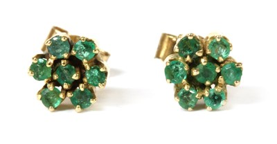 Lot 124 - A pair of gold emerald cluster earrings