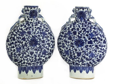 Lot 16 - A pair of Chinese blue and white moon flasks