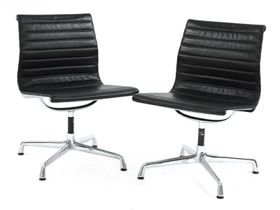 Lot 361 - A pair of Eames 'EA105' chairs