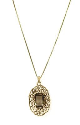 Lot 186 - A 9ct gold smoky quartz pendant, c.1970