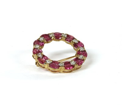 Lot 140 - A 9ct gold ruby and diamond wreath brooch