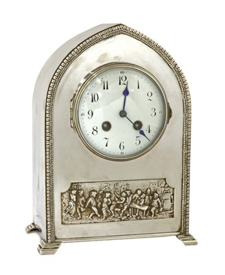 Lot 33 - An Arts and Crafts silvered mantel clock