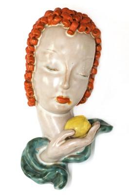 Lot 215 - A small Goldscheider pottery wall mask