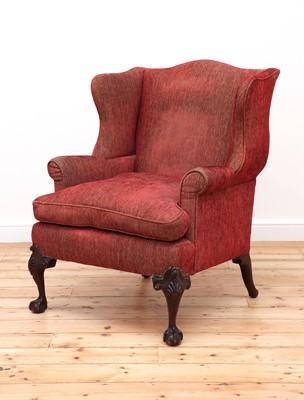 Lot 174 - A George III-style mahogany-framed wingback armchair
