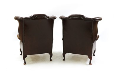Lot 297 - A pair of Queen Anne-style wingback armchairs