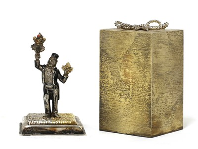 Lot 325 - *A silver-gilt 'Surprise' present
