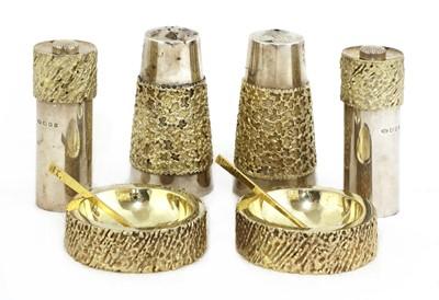 Lot 328 - *A matched silver-gilt condiment set