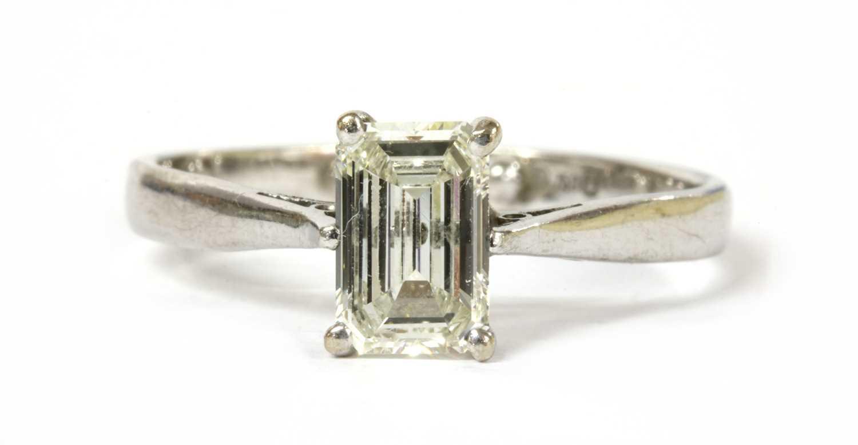 Lot 66 - An 18ct white gold single stone emerald cut diamond ring