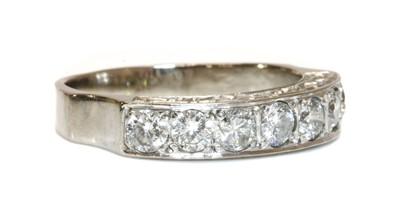 Lot 44 - An 18ct white gold seven stone diamond half eternity ring