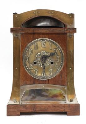Lot 11 - A secessionist oak mantel clock
