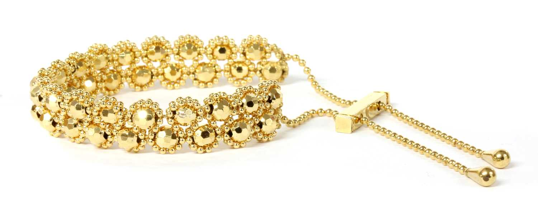 Lot 84 - A 9ct gold bead link bracelet
