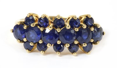 Lot 166 - A 9ct gold three row sapphire ring
