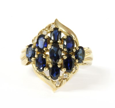 Lot 165 - A 9ct gold sapphire and diamond ring