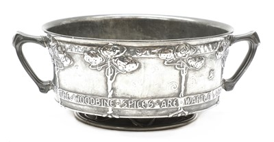 Lot 75 - A Tudric pewter twin-handled bowl
