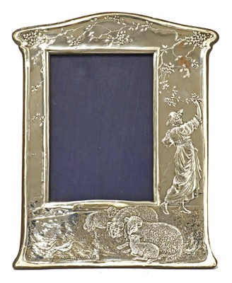 Lot 32 - An embossed silver easel-back photograph frame