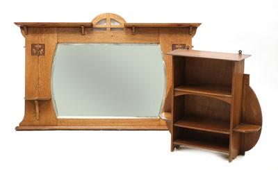 Lot 70 - An Arts and Craft oak wall mirror