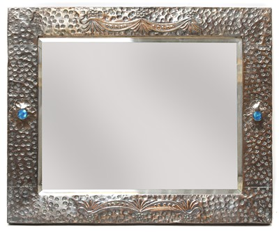 Lot 69 - An Arts and Crafts embossed copper mirror