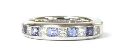 Lot 170 - An 18ct white gold tanzanite and diamond half eternity ring