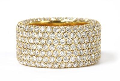 Lot 96 - A gold diamond set band ring