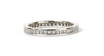 Lot 114 - A platinum princess cut diamond full eternity ring