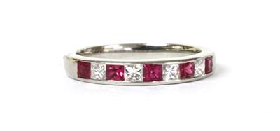 Lot 138 - A platinum ruby and diamond half eternity ring