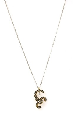 Lot 101 - An 18ct gold diamond set Scorpio pendant