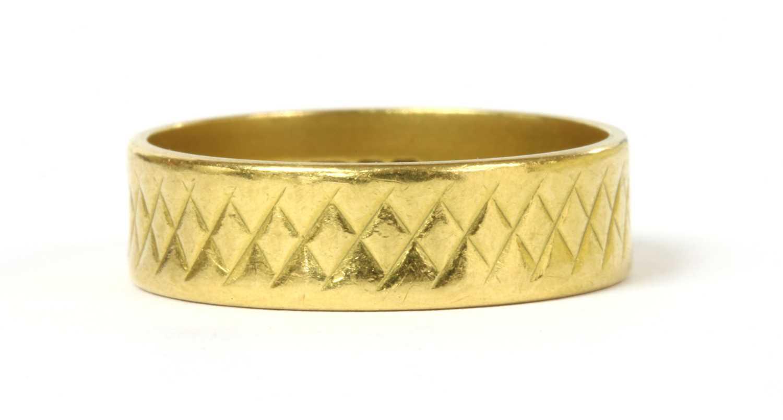 Lot 54 - A 22ct gold diamond cut flat section wedding ring