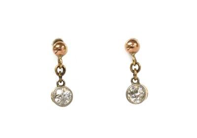 Lot 11 - A pair of Edwardian gold diamond drop earrings