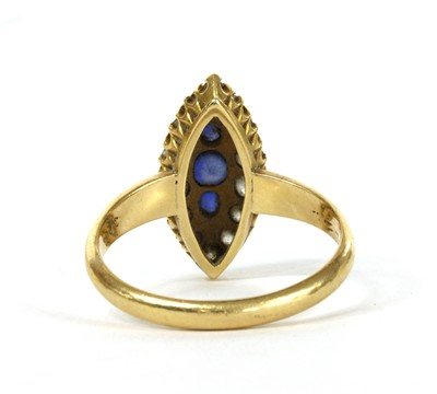 Lot 9 - An Edwardian 18ct gold sapphire and diamond marquise cluster ring