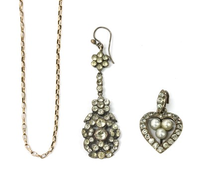 Lot 22 - A silver paste and imitation pearl heart shaped pendant