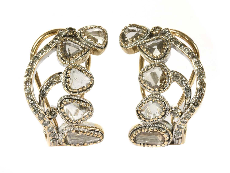 Lot 98 - A pair of gold lasque cut diamond earrings