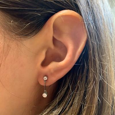 Lot 12 - A pair of early 20th century diamond drop earrings