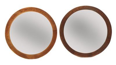 Lot 84 - A pair of Arts and Crafts circular oak wall mirrors