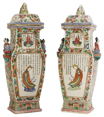 Lot 37 - A pair of Chinese famille rose vases and covers