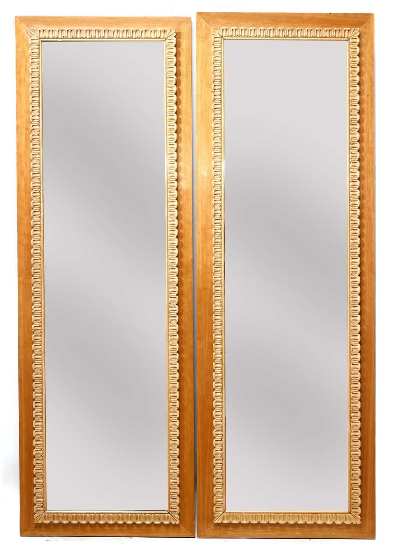 Lot 672 - A pair of Italian walnut mirrors