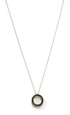 Lot 130 - A white gold black and white diamond pendant
