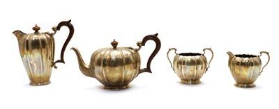 Lot 82 - A four piece composed silver tea service