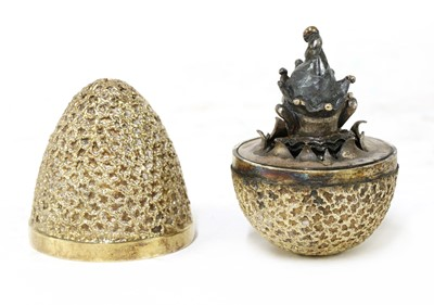 Lot 329 - *A silver-gilt novelty 'Surprise' Easter egg